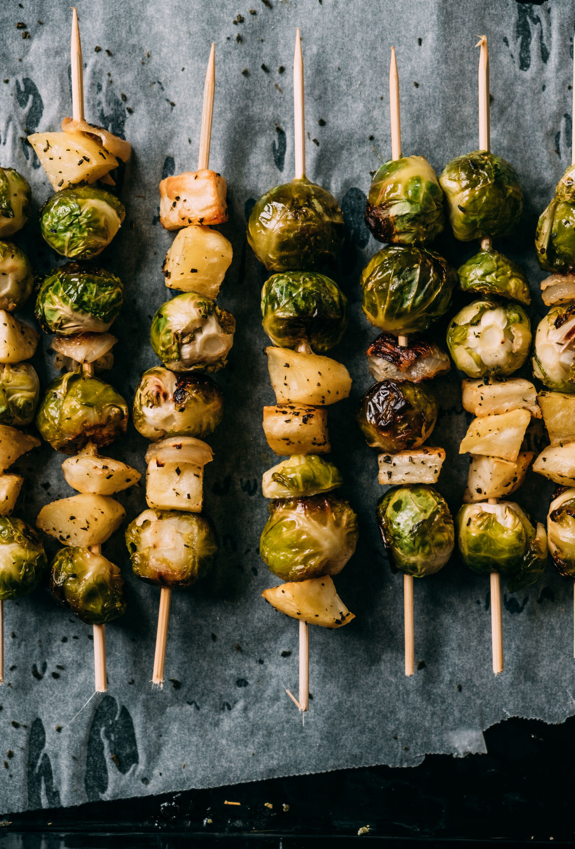 Brussels Sprouts Skewers with roasted potatoes and onion